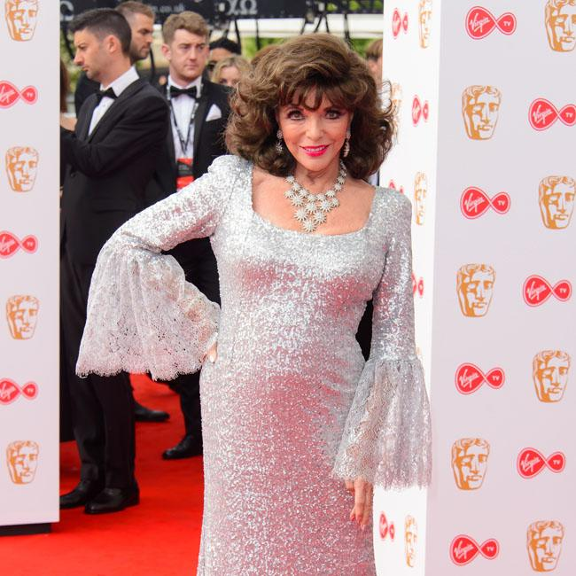 Dame Joan Collins wasn't allowed to keep costumes from The Flintstones In Viva Rock Vegas